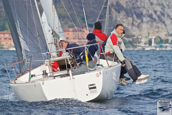 J/24 sailing off Italy's Carrara marble mountains