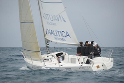 J/80 Nautica Watches sailing off Barcelona, Spain