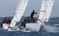 J/24 sailboats rounding a mark