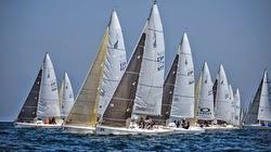 J/80 sailboats- sailing off start in Santander, Spain