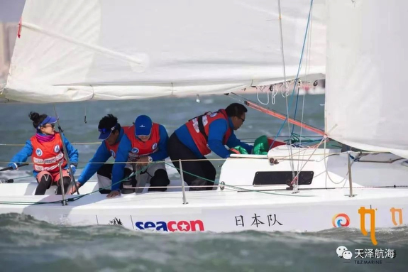 J/80 sailing off Xiamen, China