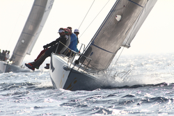J/80 sailing off Italy