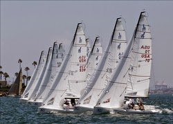 J/70 sailboats- sailing off start