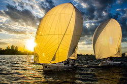 J/70s sailing at sunset in Moscow, Russia summer sailing series