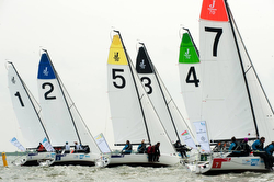 J70s sailing off start at Netherlands Sailing League