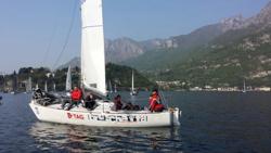 J/24 sailing Lake Como
