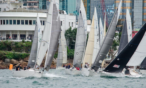 J/80s sailing off Royal Hong Kong Yacht Club