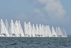 J/70s sailing off starting line