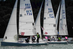 J/70s sailing team racing off Royal Yacht Squadron