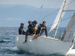 Italian J/24 ARIA sailing off Sardinia, Italy