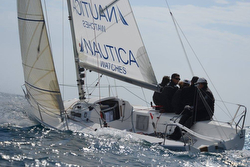 J/80 Nautica Watches sailing off Barcelona, Spain