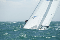 J/24s sailing in big waves off Australia