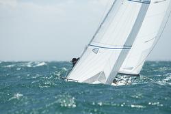 J/24s sailing in big waves off Australia