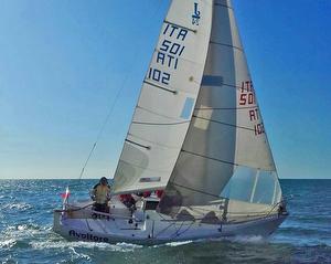 J/24 sailing off Italy