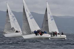 J/24 Italy fleet sailing off Sardinia, Italy