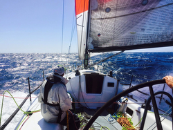 J/125 sailing fast on Cabo Race