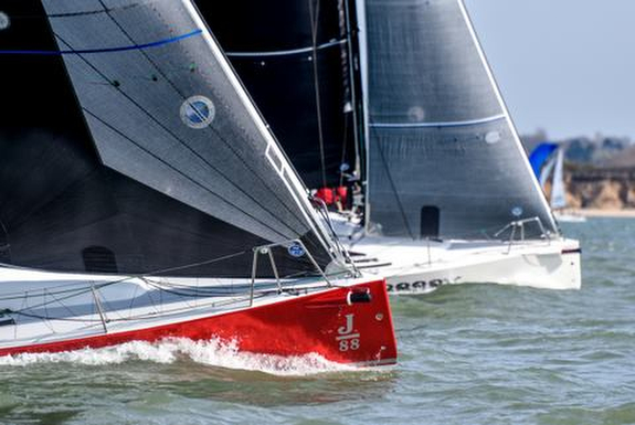 J/88s sailing upwind on the Solent