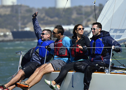 J/24 sailboat crew having fun sailing!
