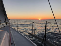 J/111 sailing Chicago Mac Race- sunrise!