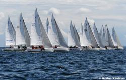 J/80s sailing off start at Kiel Week