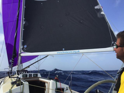 J/120 sailing downwind on RORC Transatlantic race