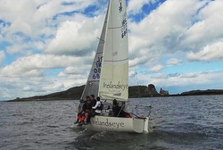 J/24 Irelands Eye Knitwear sailing off Ireland