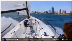 J/70 sailing fast off Chicago waterfront