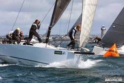J/111 sailing past mark