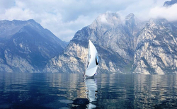 J/80 sailing the mirror on Lake Garda, Italy