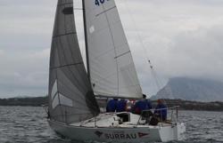 J/24 sailing off Sardinia, Italy