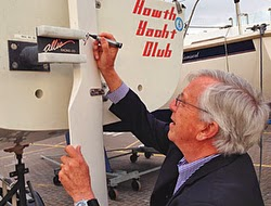 Bob Johnstone of J/Boats signing a J/24 in Ireland