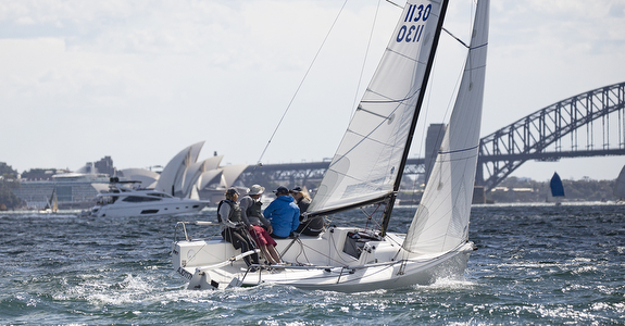 J/70 sailing by Sydney Harbour Bridge, Australia