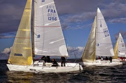 J/80 sailing upwind off Lorient, France