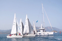 J24s sailing off Italy