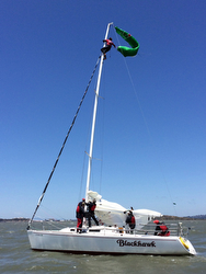 Johnny Heineken rescuing kite off J/105 masthead