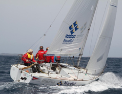 J/24 sailing off Italy