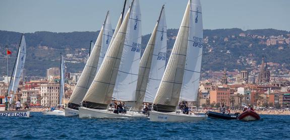 J/80s sailing off Barcelona, Spain