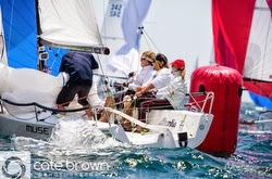 J/70 Muse sailing around mark