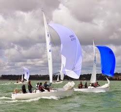 J/24 sailboats sailing downwind off Poole, England