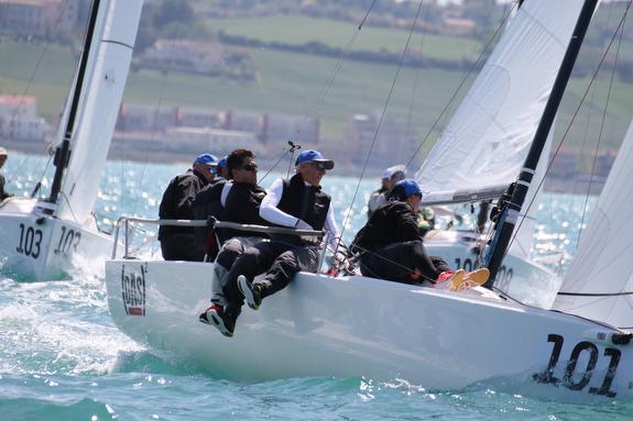 J/70s sailing past mark off Ancona, Italy