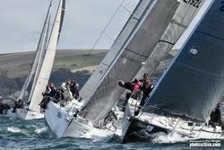 J/109 sailboats sailing at start