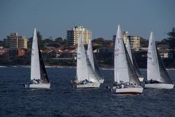 J/24s sailing off Sydney, Australia in Cronulla Sailing Club regatta