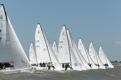 J/70s sailing start off Cowes, England