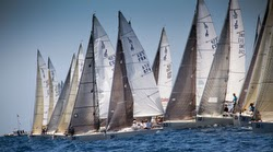 J/80s sailing off starting line