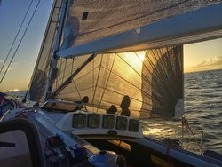 J/120 sailing at sunset on Harvest Moon Race