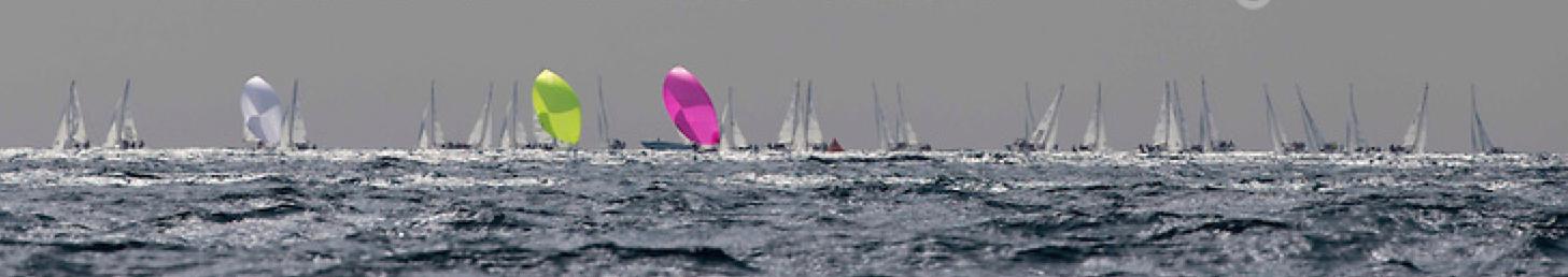 J/70s sailing on sunlit seas