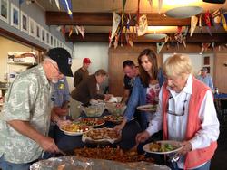 J/24 sailors eating paella dishes at Berkeley YC