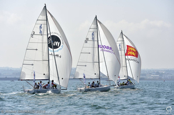 J/80 one-design sailboats under spinnaker