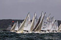 J/80 one-design sailboats off starting line