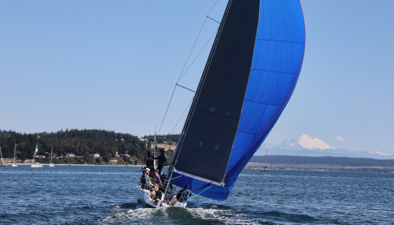 J/90 sailing Whidbey Island Race Week- Mount Baker in background